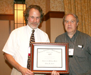 Philip Sadler receives the 2012 Millikan Medal from AAPT President David Sokoloff.