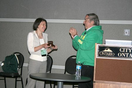 David R. Sokoloff hands the Presidential Gavel to Jill A. Marshall