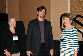 Phillip Metzger receives congratulations from Beth Cunningham, AAPT Executive Officer, and Mary Mogge, WM14 Program Chair.
