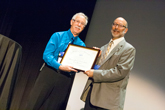 David Weintraub receives the Klopsteg Memorial Lecture Award fro AAPT Awards Chair, Steve Iona