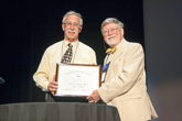 Robert Morse is presented with the Millikan Medal by Steve Iona, Chair of the AAPT Awards Committee.
