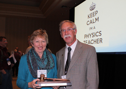 Steve Iona hands the Presidential Gavel to Mary Mogge, AAPT's 80th President.